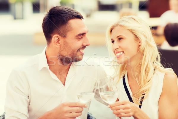happy couple clinking glasses at restaurant lounge Stock photo © dolgachov