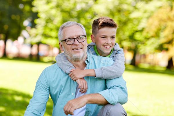 grandfather and grandson hugging at summer park Stock photo © dolgachov