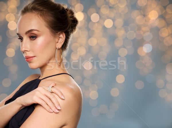Gyönyörű nő fekete visel gyémánt ékszerek emberek Stock fotó © dolgachov