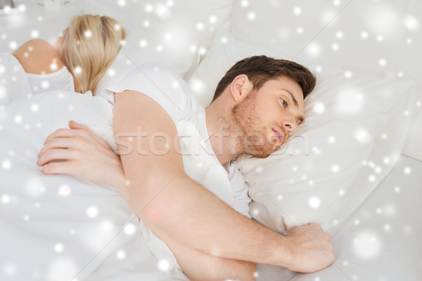 young man suffering from insomnia Stock photo © dolgachov