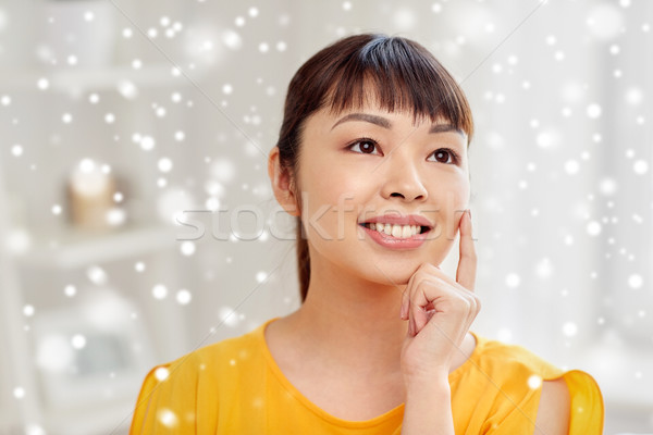 Stock photo: happy asian young dreaming woman face at home