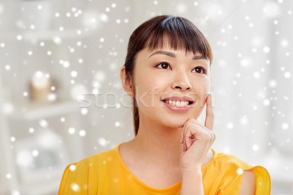 Boldog ázsiai fiatal álmodik női arc otthon Stock fotó © dolgachov