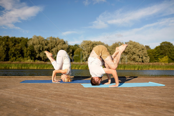 couple making yoga outdoors Stock photo © dolgachov