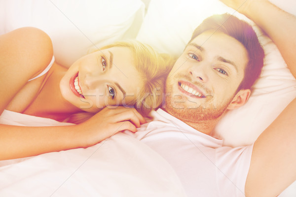 happy couple lying in bed at home Stock photo © dolgachov