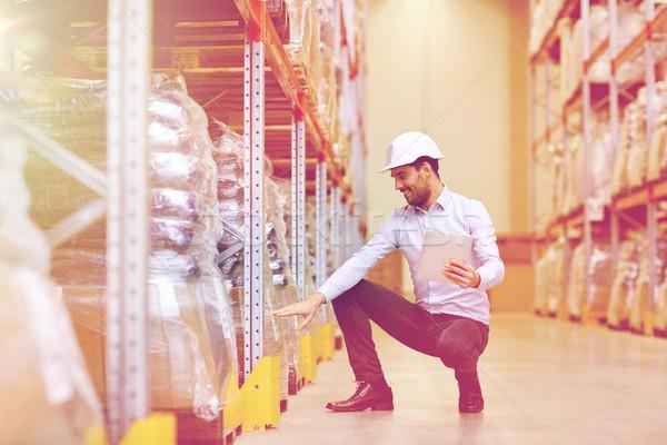 Boldog üzletember táblagép raktár nagybani eladás üzlet Stock fotó © dolgachov