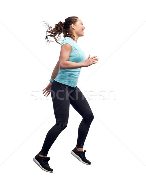 Foto stock: Feliz · sorridente · mulher · jovem · saltando · ar