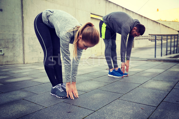 Couple vers l'avant rue fitness Photo stock © dolgachov