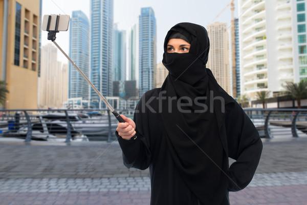 muslim woman in hijab taking selfie by smartphone Stock photo © dolgachov