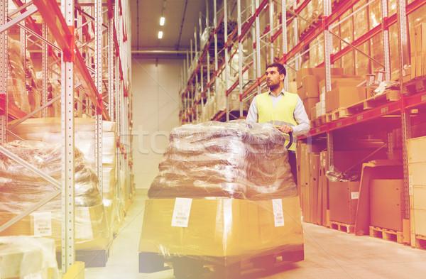 человека товары склад оптовая торговля Сток-фото © dolgachov