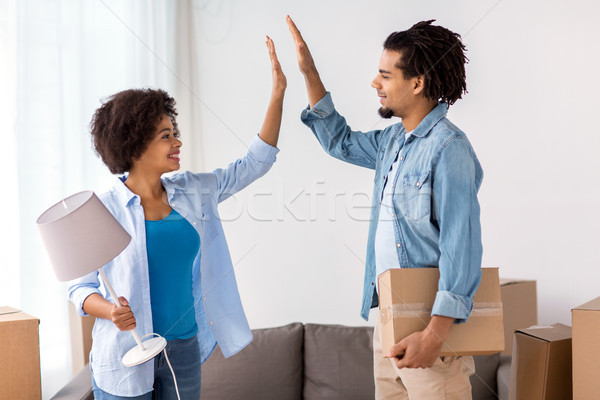 Stock photo: happy couple with stuff moving to new home