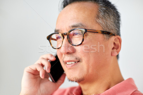 close up of man calling on smartphone at home Stock photo © dolgachov