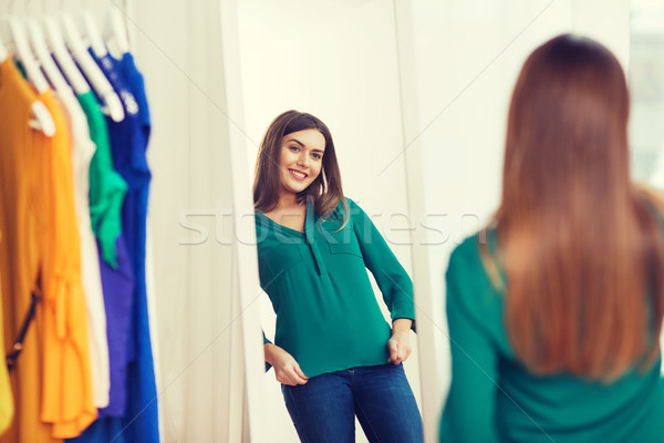 Stock photo: happy woman posing at mirror in home wardrobe