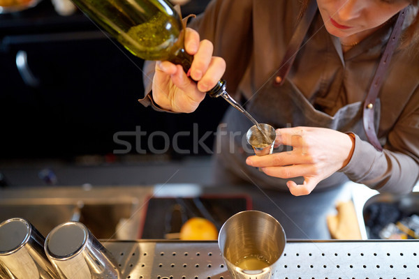 bartender pouring alcohol into jigger at bar Stock photo © dolgachov