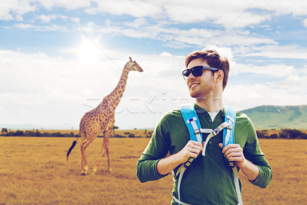 happy man with backpack traveling in africa Stock photo © dolgachov