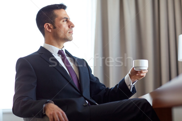 businessman drinking coffee at hotel room Stock photo © dolgachov