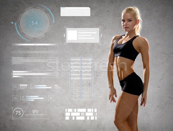 Stock fotó: Nő · sportruha · pózol · mutat · izmok · sport