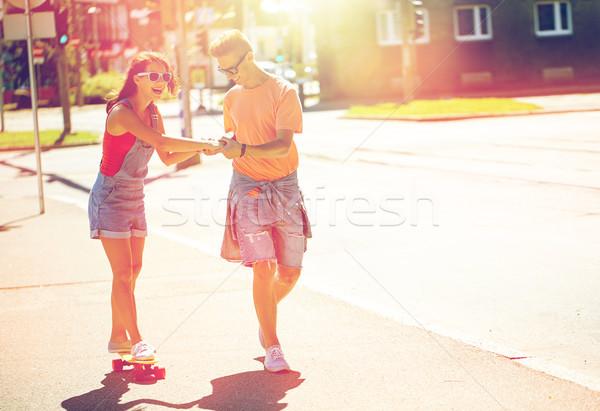 十代の カップル ライディング 街 夏 休日 ストックフォト © dolgachov