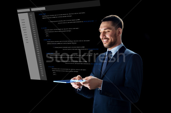üzletember táblagép virtuális kódolás üzletemberek jövő Stock fotó © dolgachov