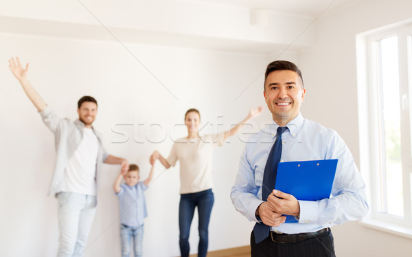realtor with clipboard and family at new home Stock photo © dolgachov
