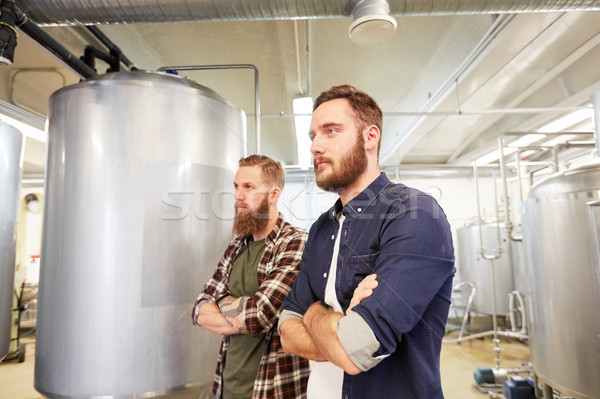 men at craft brewery or beer plant Stock photo © dolgachov