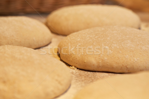 close up of yeast bread dough at bakery Stock photo © dolgachov