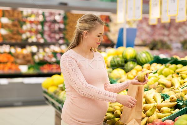 Donna incinta bag acquisto pere alimentari vendita Foto d'archivio © dolgachov