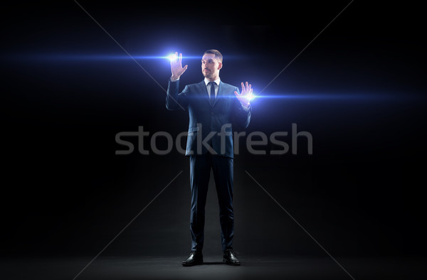 üzletember lézer fény fekete üzletemberek jövő Stock fotó © dolgachov