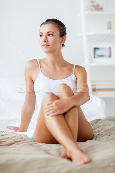 Stock photo: beautiful woman with bare legs on bed at home