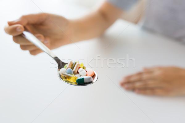 женщины стороны ложку таблетки Сток-фото © dolgachov