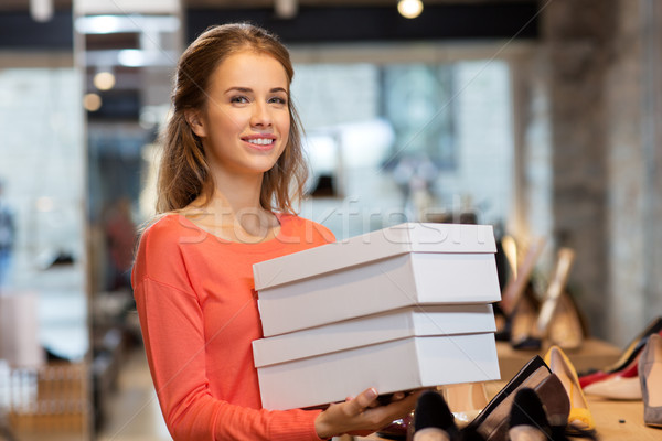 woman or shop assistant with shoe boxes at store Stock photo © dolgachov