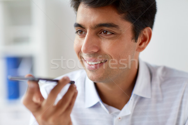 close up of man using voice recorder on smartphone Stock photo © dolgachov