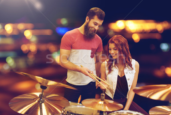 man and woman with drum kit at music store Stock photo © dolgachov