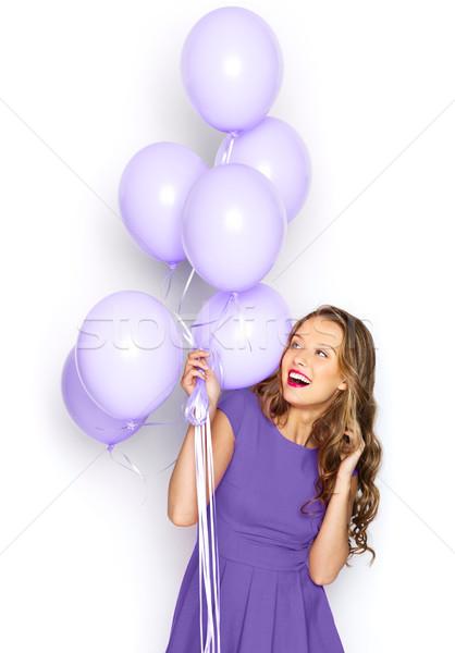 Boldog lány ibolya ruha léggömbök emberek ünnepek Stock fotó © dolgachov