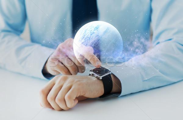 рук планеты голограмма Smart Смотреть бизнеса Сток-фото © dolgachov