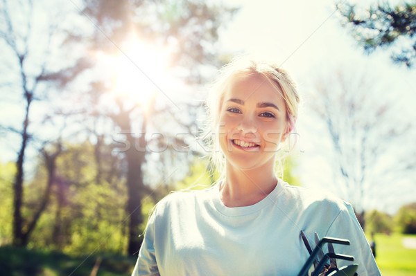 happy young volunteer woman outdoors Stock photo © dolgachov