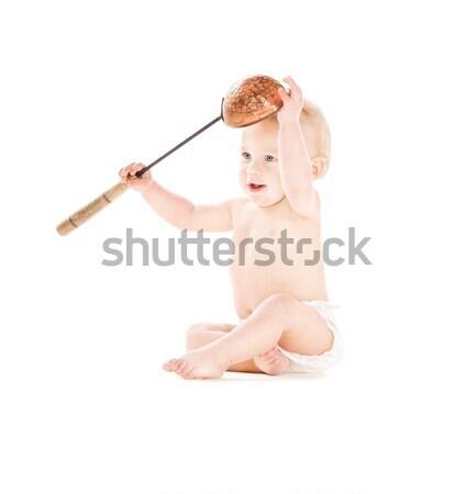 baby boy with big spoon Stock photo © dolgachov