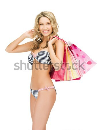 seductive woman in sexy lingerie with shopping bags Stock photo © dolgachov