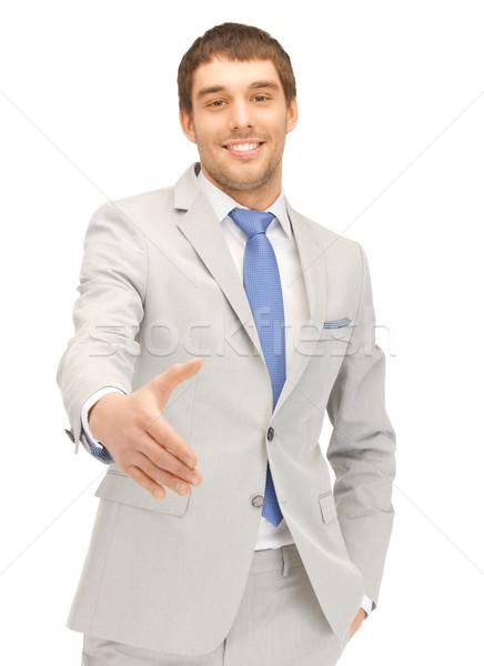 Homem abrir mão pronto aperto de mão homem bonito Foto stock © dolgachov