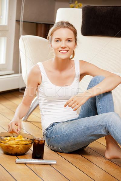 улыбаясь пультом фотография женщину продовольствие Сток-фото © dolgachov