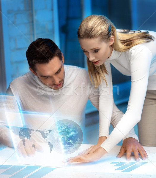 man and woman working with virtual screen Stock photo © dolgachov
