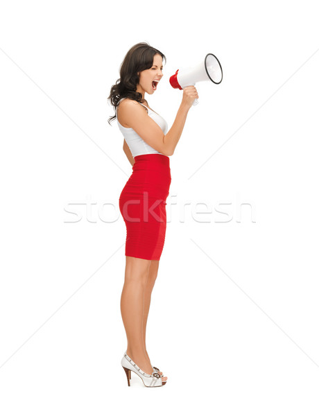 strict woman shouting in megaphone Stock photo © dolgachov