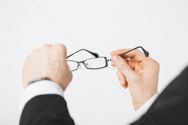 man hands holding eyeglasses Stock photo © dolgachov