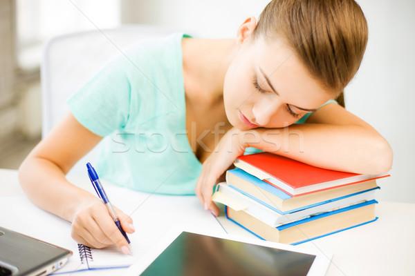 Fáradt diák alszik stock könyvek kép Stock fotó © dolgachov