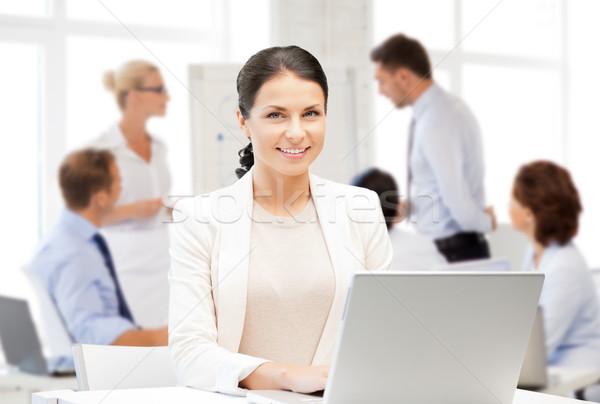 businesswoman with laptop computer at work Stock photo © dolgachov