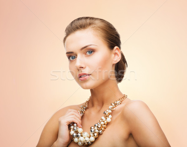 woman wearing pearl statement necklace Stock photo © dolgachov