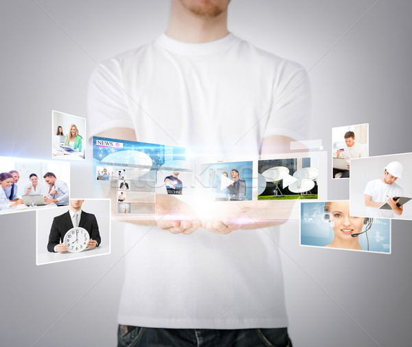 man hands with virtual screens Stock photo © dolgachov