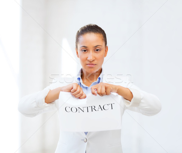 african businesswoman tearing contract Stock photo © dolgachov