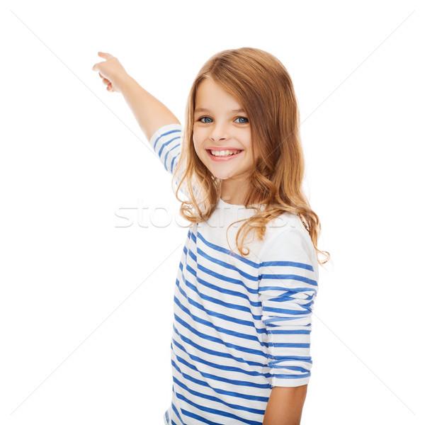 Sorridente menina indicação virtual tela educação Foto stock © dolgachov