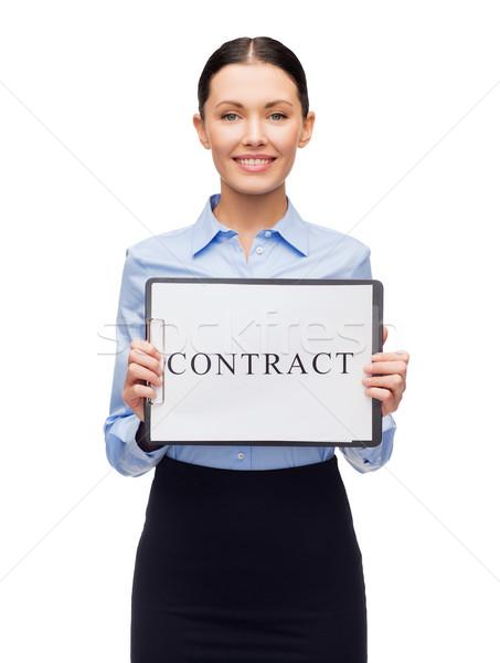 улыбаясь деловая женщина договор бизнеса дружественный молодые Сток-фото © dolgachov