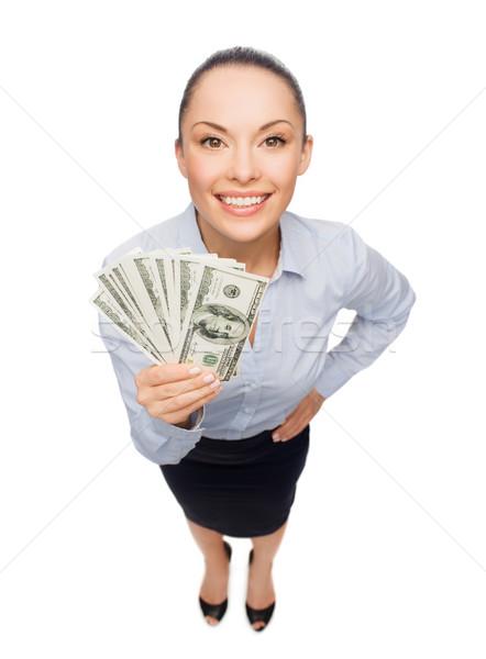 Souriant femme d'affaires dollar trésorerie argent affaires Photo stock © dolgachov